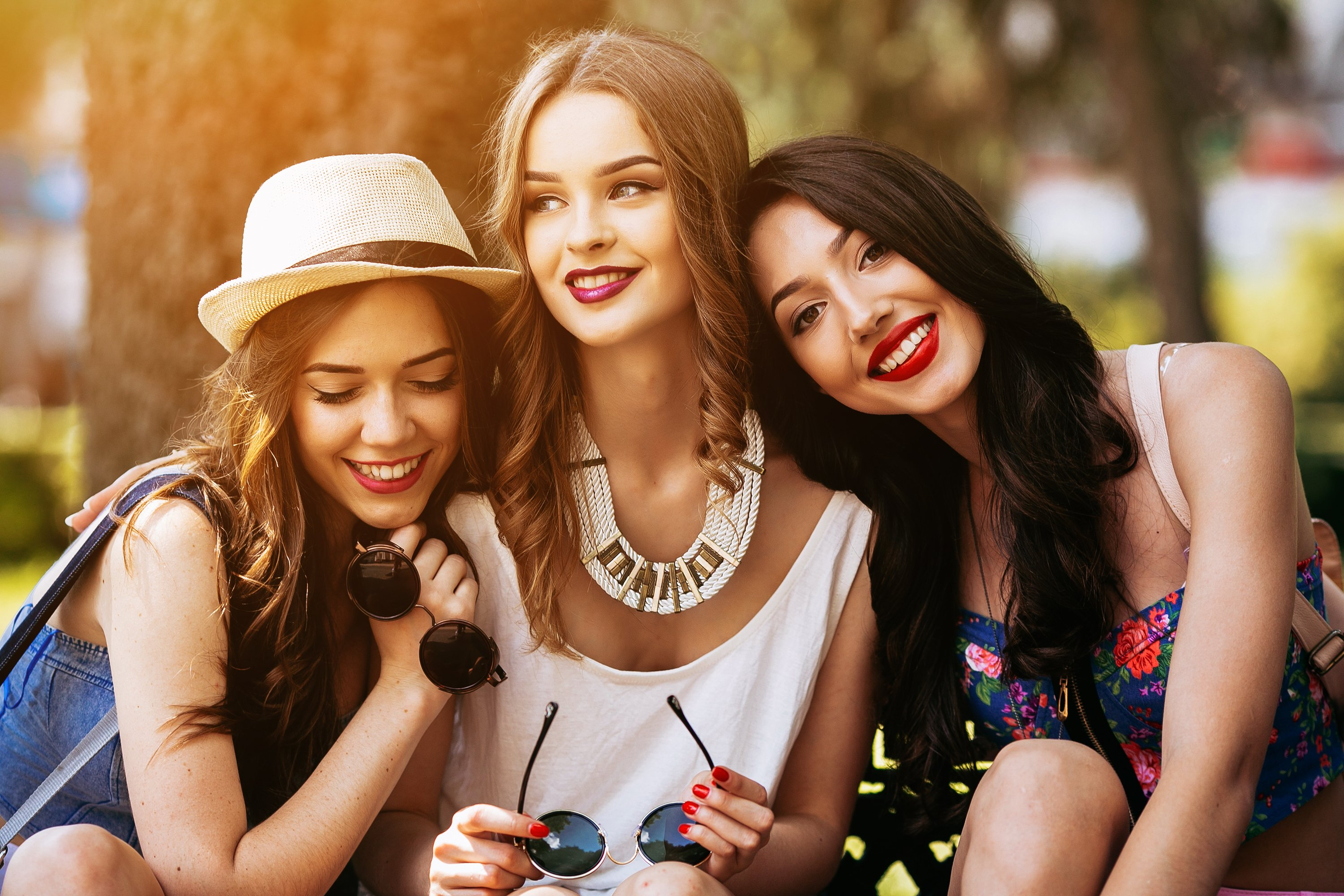 Three,Beautiful,Young,Girls,Posing,Against,The,Backdrop,Of,The